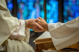 Archbishop anoints the ordinand's hands