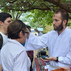 Brian Strassburger, SJ, distributes ashes in Managua, Nicaragua.